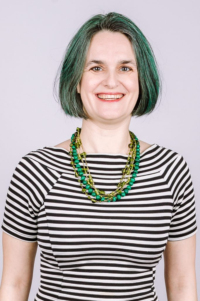 Annastasia Ward - Consistent Social Media in black and white stripes with green hair